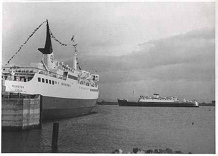 Photographic card of the 1948 Munster (4) (or Leinster (4)) passing the new 1969 Munster (5).