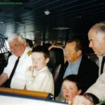 Captain Peter Ferguson and guests on the bridge